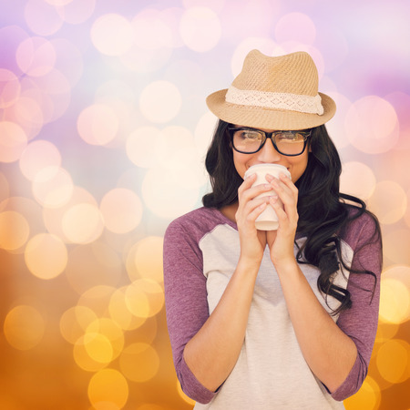 disposable cup: Brunette with disposable cup against glowing background