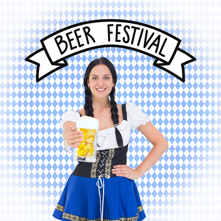 tankard: Pretty oktoberfest girl holding beer tankard against blue pattern
