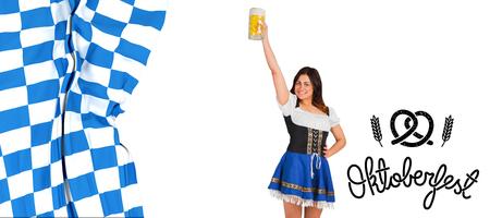tankard: Pretty oktoberfest girl raising beer tankard against oktoberfest graphics