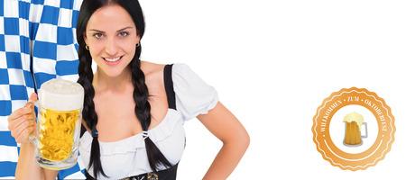 tankard: Pretty oktoberfest girl holding beer tankard against oktoberfest graphics