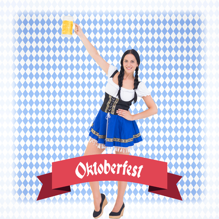 tankard: Pretty oktoberfest girl holding beer tankard against blue pattern