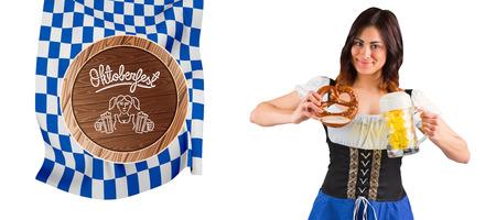 tankard: Pretty oktoberfest girl holding beer tankard and pretzel against oktoberfest graphics