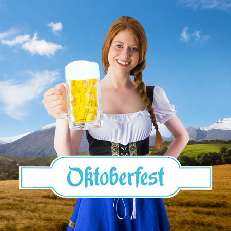 tankard: Oktoberfest girl smiling at camera holding beer against country scene with mountain