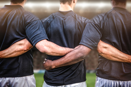 team sports: Rugby fans in arena against rugby players standing together before match Stock Photo