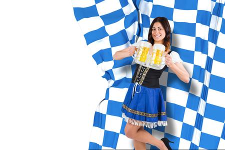 tankard: Pretty oktoberfest girl holding beer tankards against blue and white flag Stock Photo