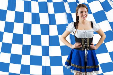 checker flag: Pretty oktoberfest girl smiling at camera against blue and white flag
