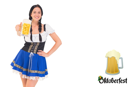 tankard: Pretty oktoberfest girl holding beer tankard against oktoberfest graphics