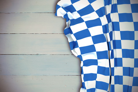 checker flag: Blue and white flag against painted blue wooden planks Stock Photo