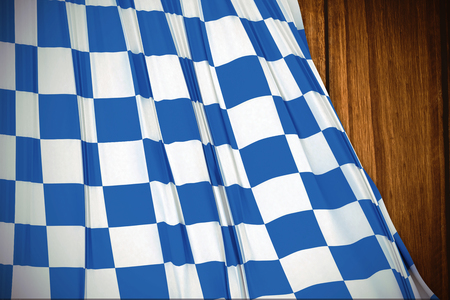 checker flag: Blue and white flag against wooden table