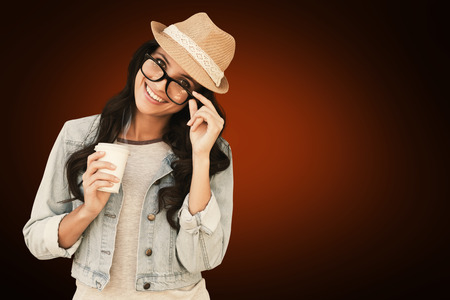 disposable cup: Brunette with disposable cup against orange background with vignette