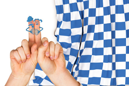 checker flag: Oktoberfest character fingers against blue and white flag