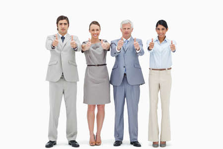 thumbsup: Multicultural business team approuving with their thumbs-up against white background LANG_EVOIMAGES