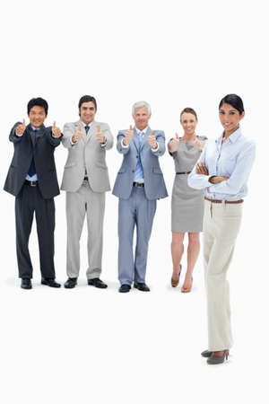thumbsup: Multicultural business team with their thumbs-up with a woman in foreground against white background