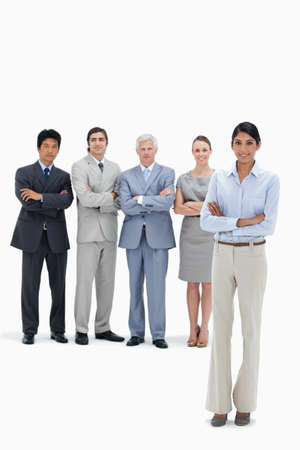 arms folded: Smiling multicultural business team with their arms folded with a woman in foreground LANG_EVOIMAGES
