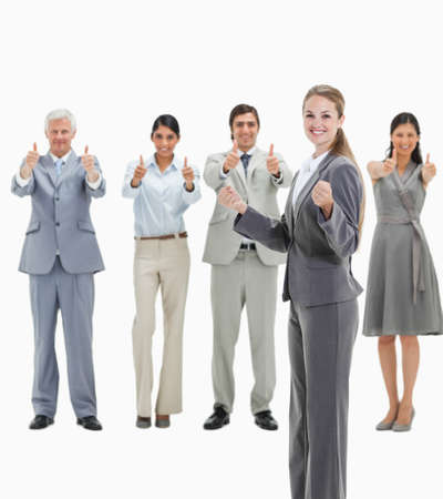 approving: Blonde woman with business people approving behind her against white background