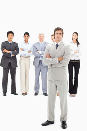 arms folded: Multicultural business team with their arms folded focus on a man in foreground