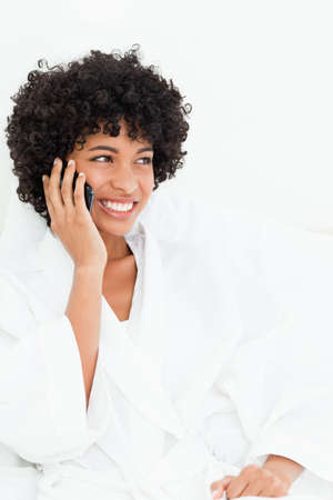 frizzy: Close-up of a frizzy haired woman making a call in a robe LANG_EVOIMAGES