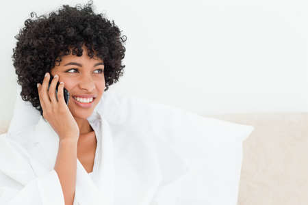 frizzy: Frizzy haired woman making a call in a robe LANG_EVOIMAGES