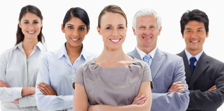 arms folded: Big close-up of a smiling business team with their arms folded against white background