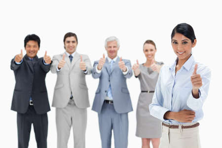 thumbsup: Close-up of a multicultural business team with their thumbs-up with a smiling woman in foreground against white background