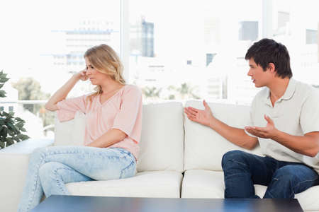 apologise: A man is turned to the woman, arms out trying to apologise, but the woman is ignoring him by turning the other way.