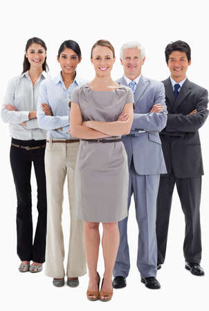 arms folded: Smiling business team with their arms folded against white background