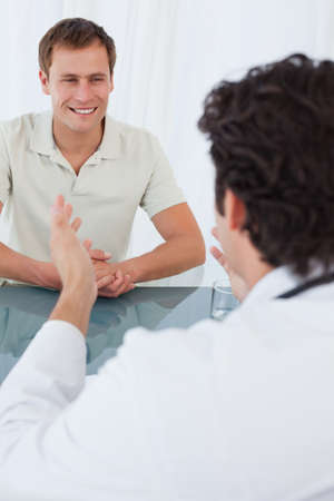 medical man: Male doctor talking to his smiling patient