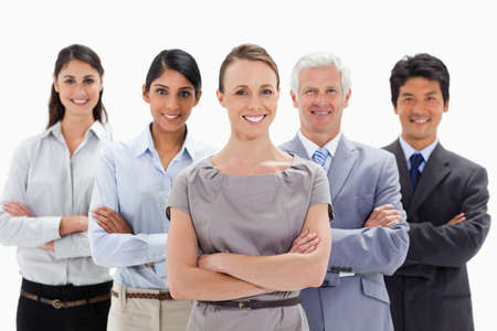 arms folded: Close-up of a smiling business team with their arms folded against white background