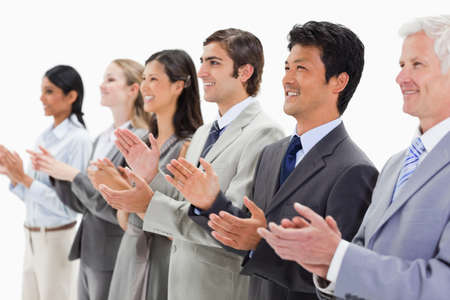 applauding: Happy multicultural business people applauding against white background