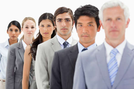 single line: Close-up of business people in a single line with focus on the fourth person against white background LANG_EVOIMAGES