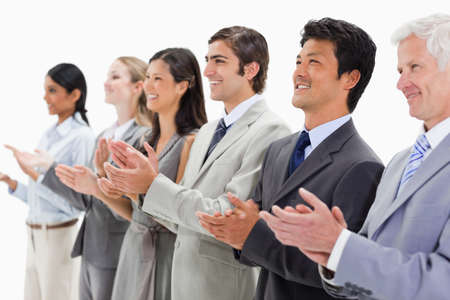 applauding: Smiling multicultural business people applauding against white background