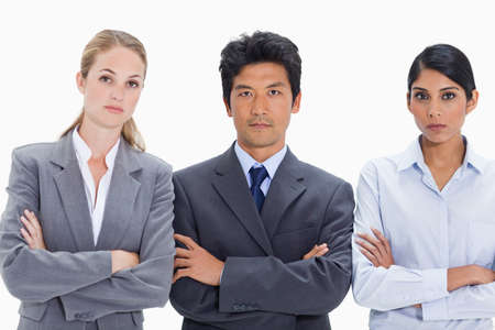 arms folded: Close-up of business people with their arms folded against white background LANG_EVOIMAGES