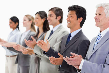 applauding: Multicultural business people applauding against white background LANG_EVOIMAGES