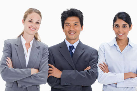 arms folded: Smiling business people with their arms folded against white background