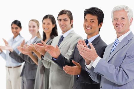 applauding: Close-up of multicultural business people applauding against white background