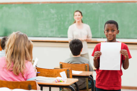 the pupil: Elementary pupil showing his test results