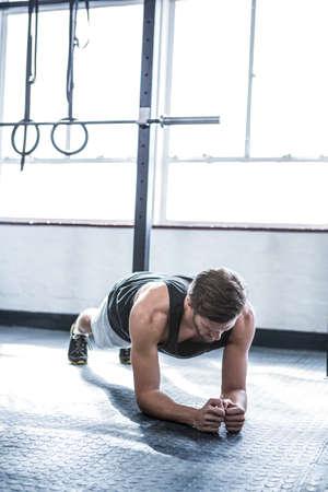man working out: Fit man working out in studio at crossfit gym LANG_EVOIMAGES