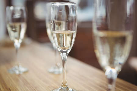 celebratory event: Champagne glasses on table during celebration at office