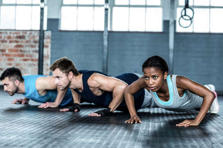 push up: Fit people doing push up together in crossfit