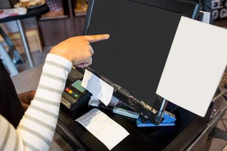 till: Waitress using touchscreen at till in the canteen LANG_EVOIMAGES