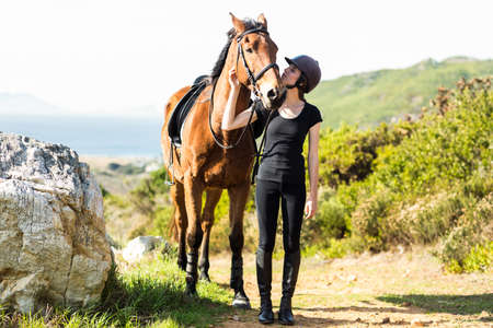 horse love horse kiss animal love: Happy woman walking with her horse in the countryside