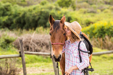 horse love horse kiss animal love: Young woman with her horse in the countryside LANG_EVOIMAGES