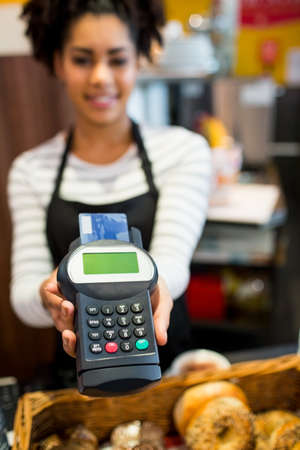 pin entry: Customer paying with credit card in the cafe