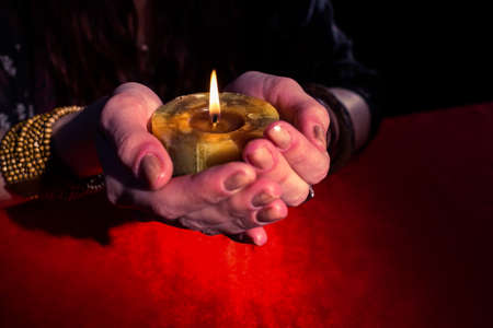 telepathy: Close-up of of fortune teller woman holding candle