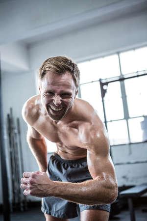 man power: Fit man shouting at camera at crossfit gym
