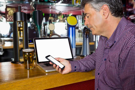 grey hair: Man with grey hair working in the pub