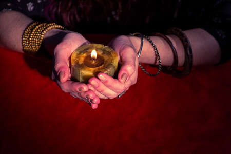 telepathy: High angle view of fortune teller holding candle