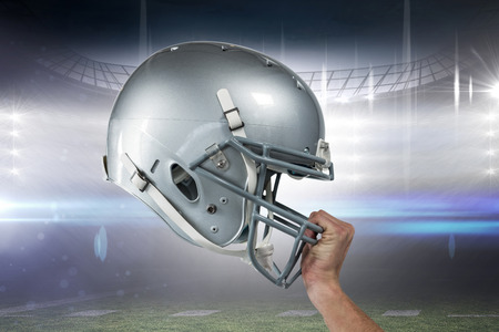 sliver: Close-up of American football player handing his sliver helmet against american football arena