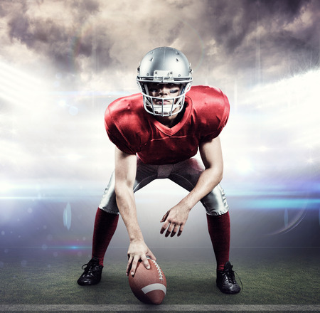 football world cup: American football player holding helmet against american football arena
