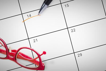 reading glasses: Reading glasses against january calendar Stock Photo